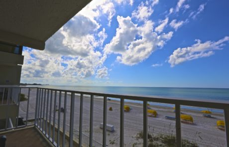 Balcony view. Beach with Gulf of Mexico in the background