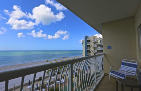 Balcony view, patio in the foreground with the beach and Gulf of Mexico in the background.